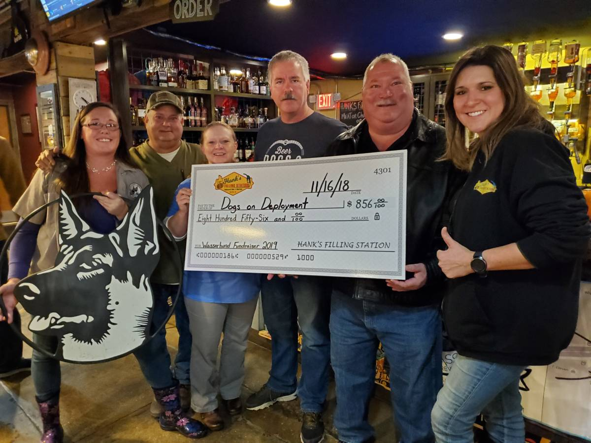 Hank's check presentation to Dogs on Deployment, with Wasserhund Brewing