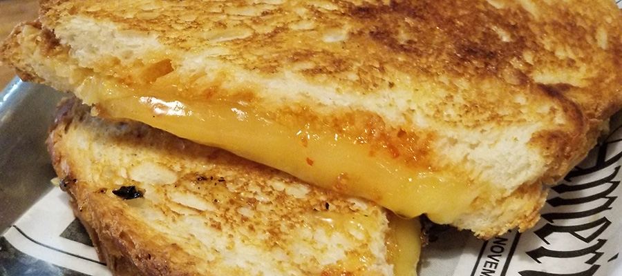 Raclette cheese and red pepper jam grilled cheese